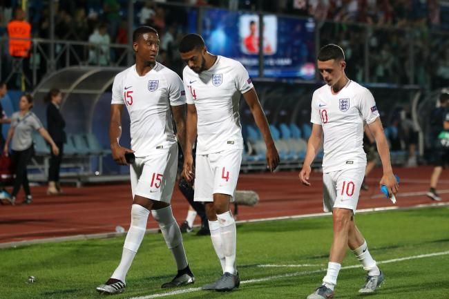 Ezri Konsa (left), Jake Clarke-Salter (centre) and Phil Foden are left dejected after England Under-21s' 3-3 draw with Croatia
