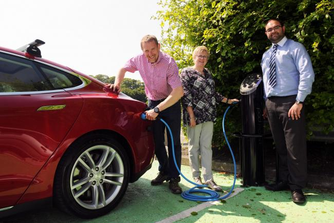 L to R William Silverstone (member of the public charging his car) Clr Hazel Evans and Thomas Evans Transport planner.