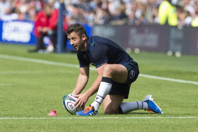 Greig Laidlaw lines up a kick against France