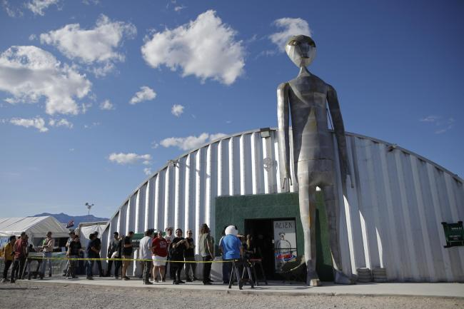 People line up outside of the gift shop at the Storm Area 51 Basecamp event