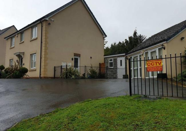 This former sales office at a residential estate in Betws has been run as a gun shop, but will now be a meals on wheels venture with the gun shop moving to the partially-built extension next door (pic by Carmarthenshire Council and free for use for a