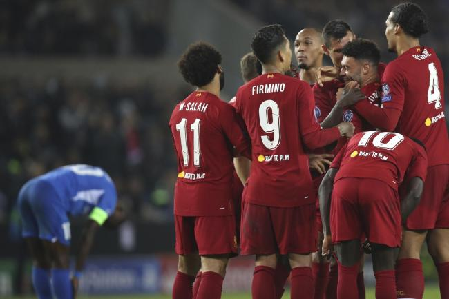 Alex Oxlade-Chamberlain, third right, is congratulated by his Liverpool team-mates