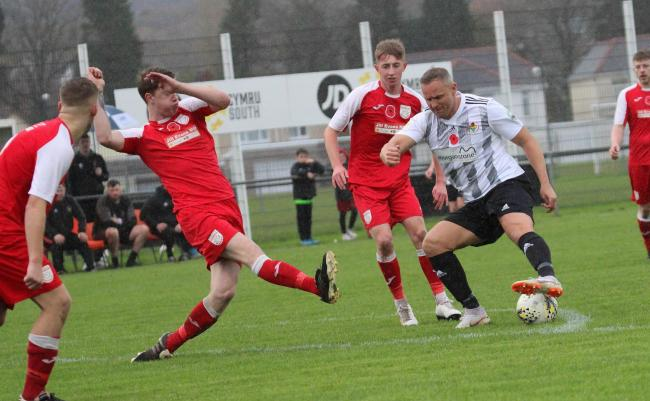 Lee Trundle of Ammanford AFC bamboozles the Ton Pentre defence in the last round of the Welsh Cup. Pic: SDD.