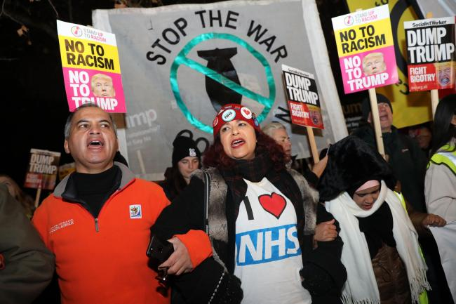 NHS nurses and doctors in central London during a protest against Donald Trump, who is in the capital as Nato leaders gather to mark 70 years of the alliance