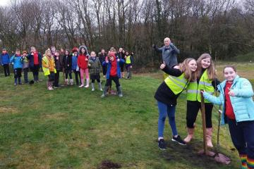 Primary school children plant trees for community council scheme