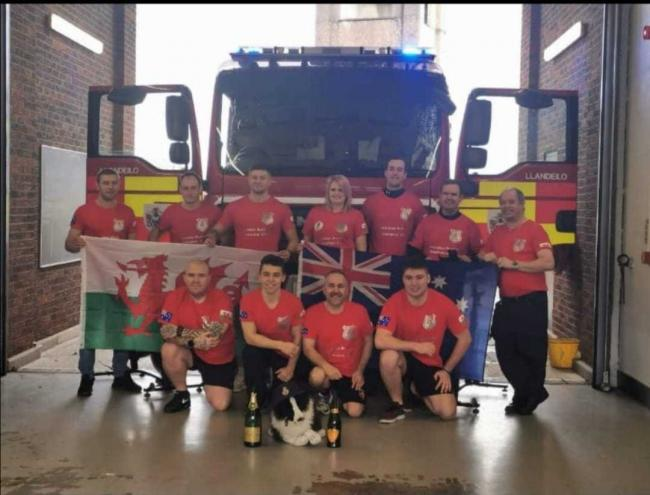 The crew at Llandeilo firestation after cycling for 22 hours to raise money for Llandilo fire station, Australia