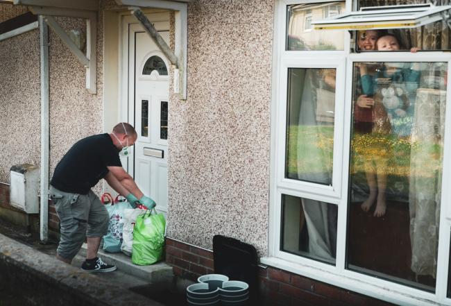 Emyr Rees, one of the volunteers from Amman Valley Foodbank delivering supplies in Brynamman.