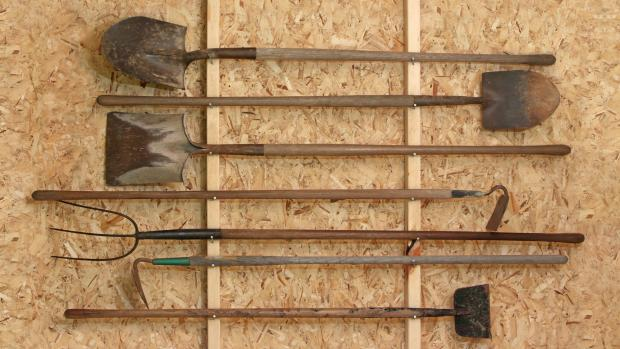 South Wales Guardian: Get heavy tools, rakes, shovels, etc., off the floor using utility hooks or, even, nails. Credit: Getty Images / Twoellis
