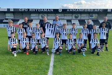 Firm helps kit out Ammanford youth team
