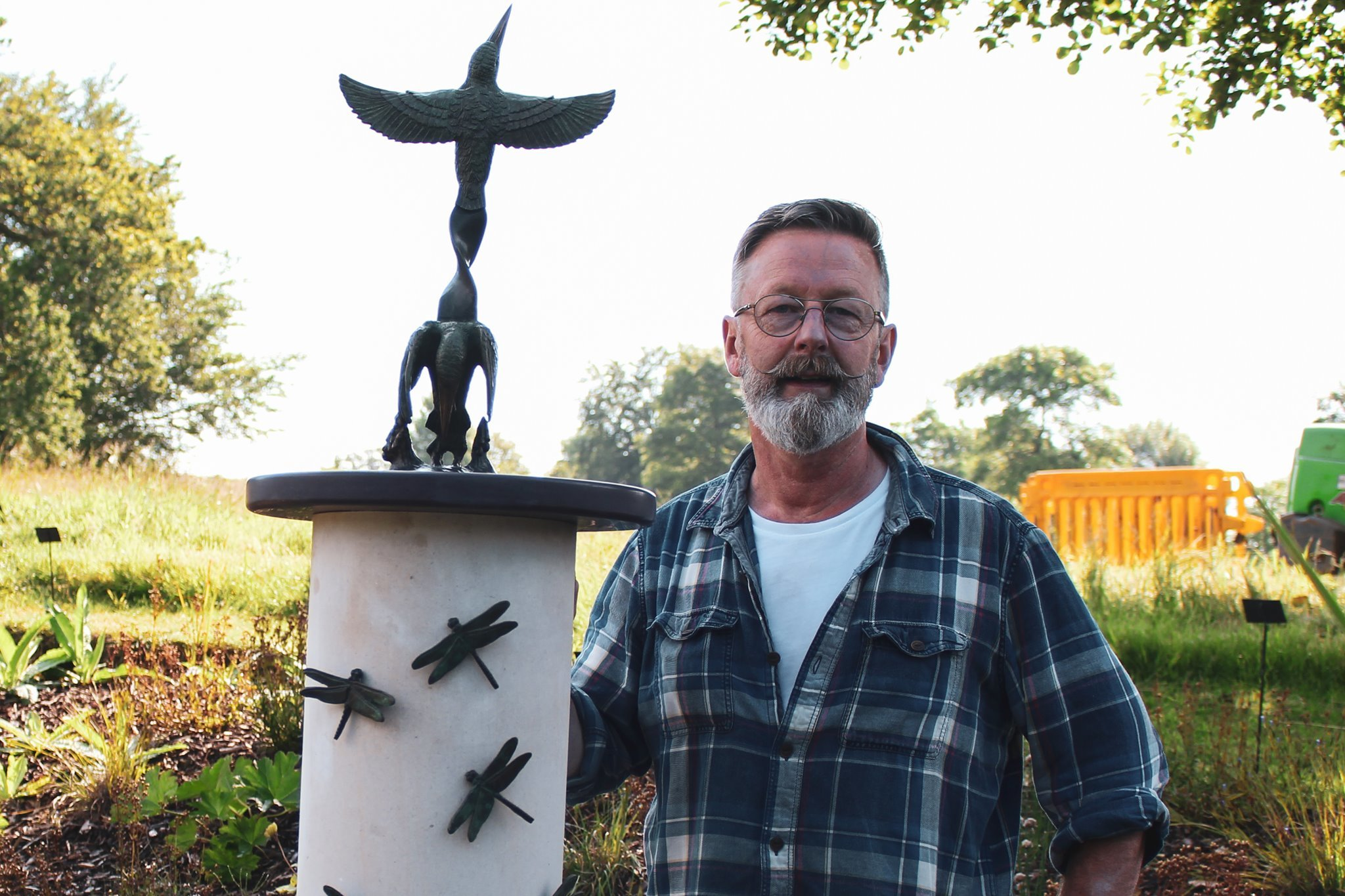 The kingfisher sculpture at the National Botanic Garden of Wales with designer, Paul Clarke