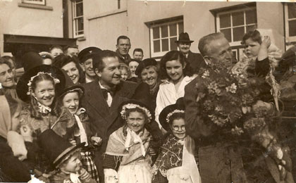 THOSE WERE THE DAYS: Donald Peers and Ammanford-born conductor Ray Jenkins are pictured with admirers outside Ammanford's Cross Inn on St David's Day 1950. (Photo kindly provided by Marion Cooper of Ammanford)