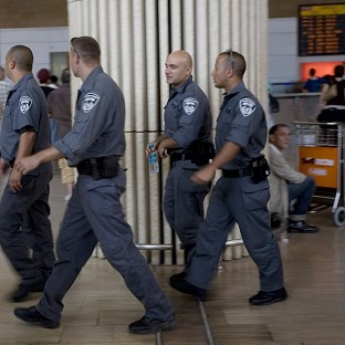 Israeli police officers at Ben Gurion airport, Israel, where 12 British people have been detained