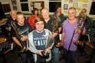 BAND ON A RUN: Ammanford Silver Band celebrate their recent success. Picture by Mark Davies.