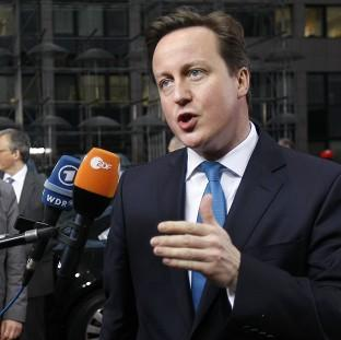 David Cameron speaks to the media at the EU summit in Brussels (AP)