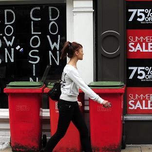 Household spending was worse than previously thought in the last quarter of 2011, figures show