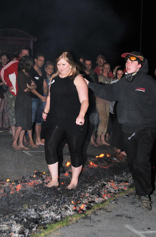 SOLES ON FIRE: Becky Isaac, a member of Amman Valley Women's Aid, braves the red-hot coals.