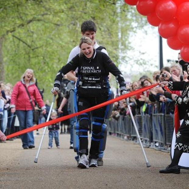 Claire Lomas approaches the finish of the London Marathon on The Mall