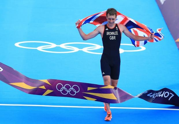 Alistair Brownlee crosses the line to win the Olympic triathlon gold medal, with younger brother Jonny finishing third to take the bronze