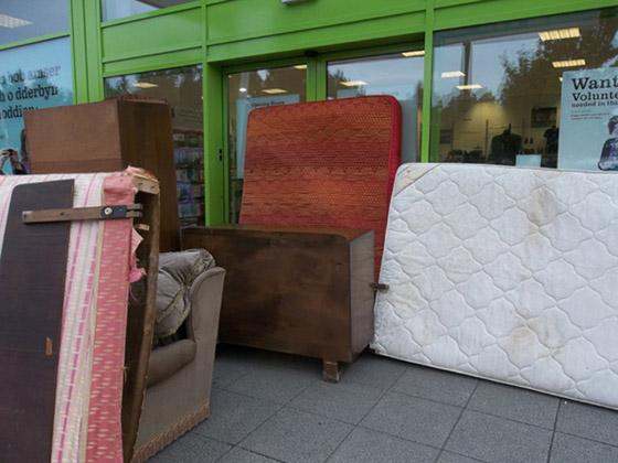 NO WAY IN: So much furniture was dumped at the shop its workers were unable to gain access.