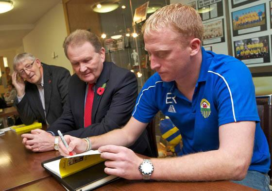 FOOTBALL IN THE GUTTER: Bryn Rovers stalwart Eifion Rogers signs copies of his book detailing the history of the club. Pic: Joe Davies.