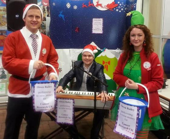 MUSIC MAN: Owen Bailey with his willing helpers - store manager Paul Collingridge and shop worker Joanne Ridd.