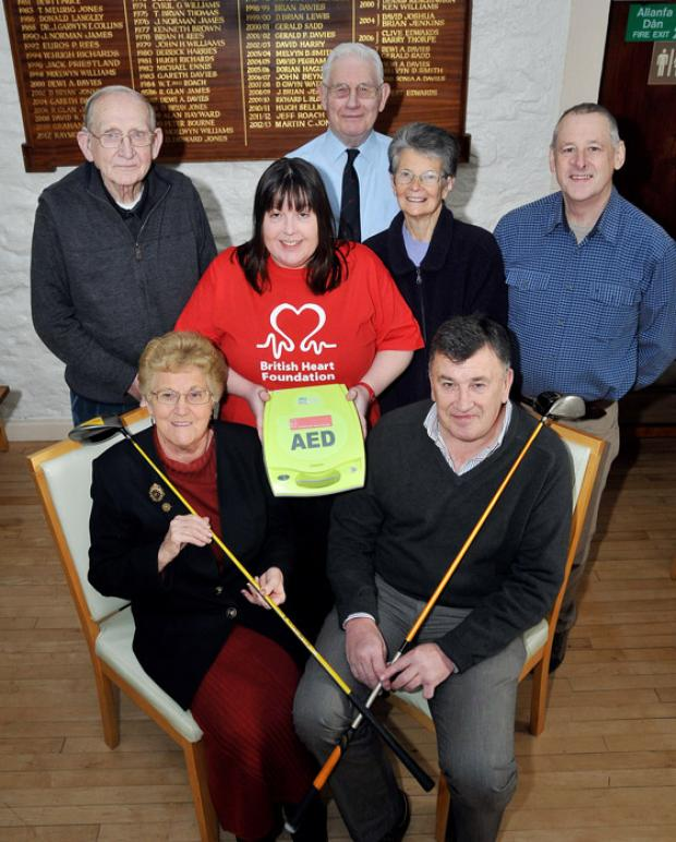 HEART OF THE MATTER: Members of the Ammanford branch of the British Heart Foundation are pictured with Jeff Roach of Glynhir Golf Club. Photo: Mark Davies