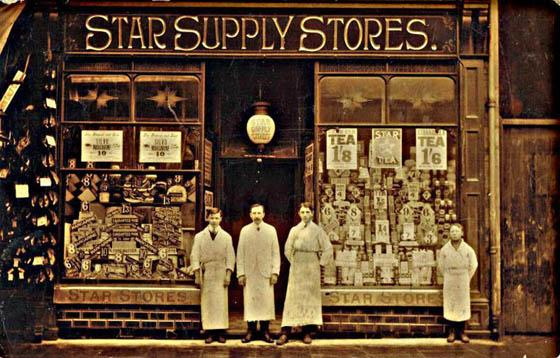 MURDER MOST FOUL: Star Supply Stores manager Thomas Thomas (centred of the three) was brutally killed 92 years ago this in what remains the Amman Valley's darkest mystery