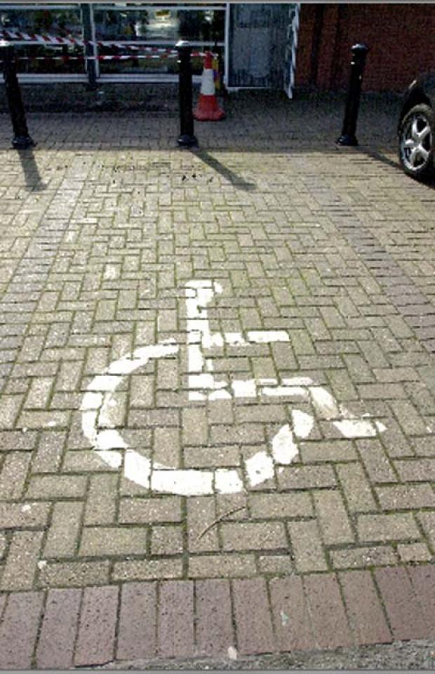 Disabled OAP cries foul over Ammanford parking bay 'blow'