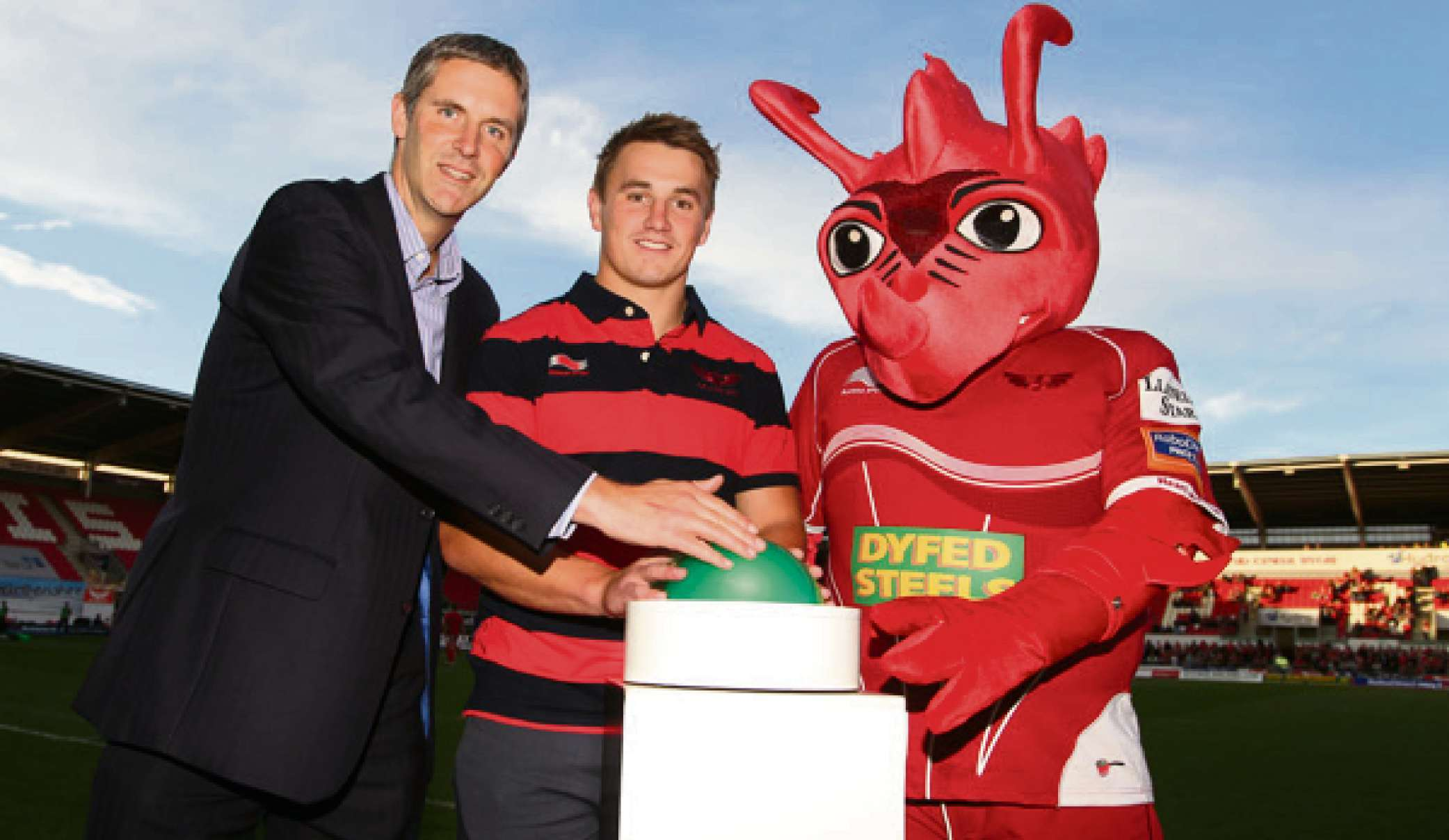 IN TUNE: Scarlets centre Jonathan Davies launched digital radio for West and Mid Wales at Parc y Scarlets on Friday evening. Pictured with Laurence Harrison from Digital Radio UK and Cochyn.