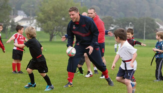 REDS ON THE ROAD: Rhys Priestland gets stuck in at Burry Port RFC as part of Scarlets' Community Roadshow. Pic: Riley Sports Photography
