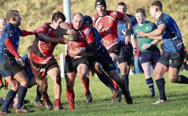 South Wales Guardian: MANNING UP: Amman Utd's Trystan Manning takes on Loughor in the SWALEC Plate.Pic: SDD
