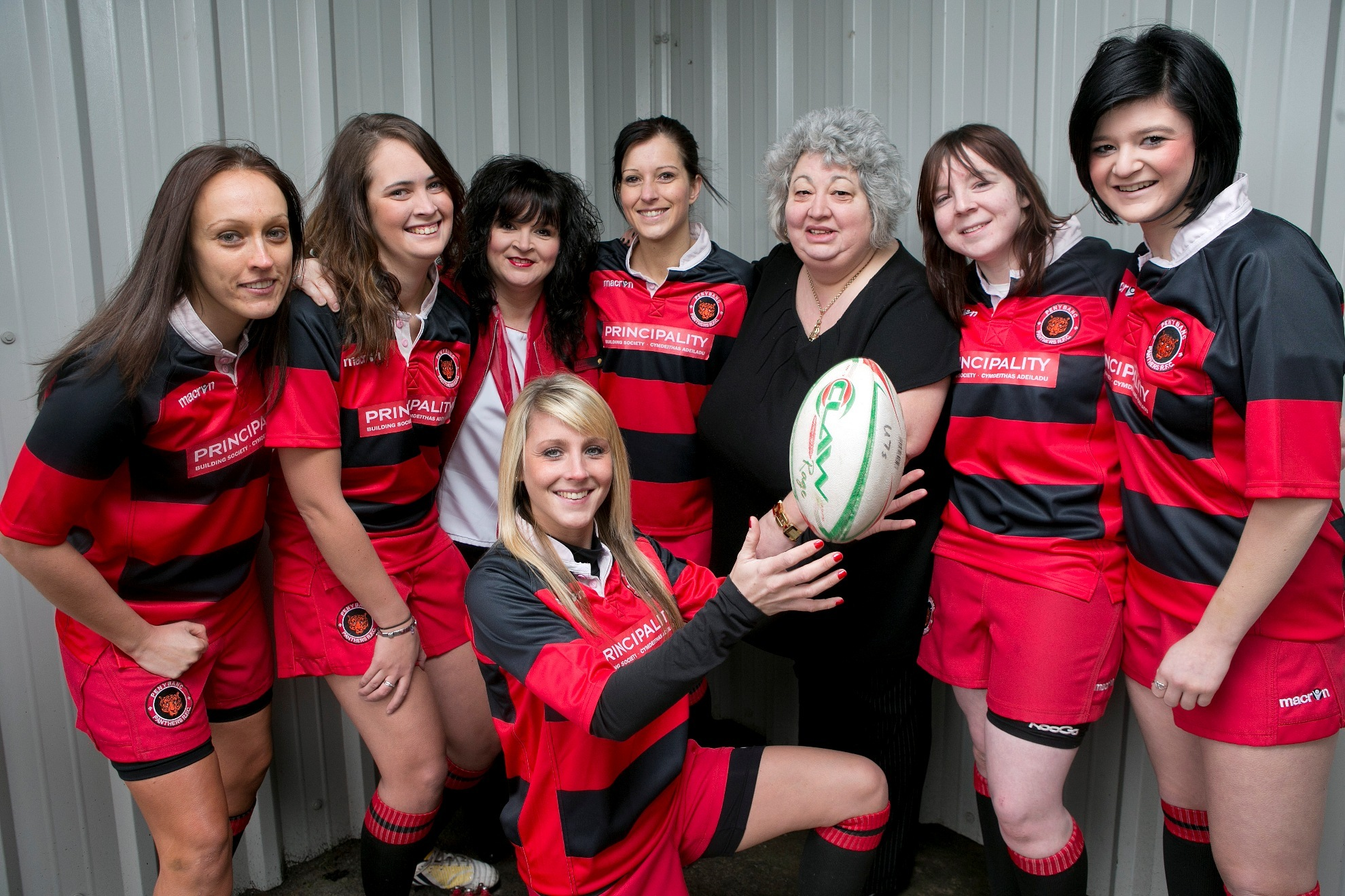 COOL CATS: Penybanc Panthers Ceri Thomas, Lowri Chapman, Gemma Davies, Amy Jenkins, Leah Pompa and Leanne Macbeth (kneeling) with Principality Building Society's Virginia Linnell and Julie Evans.
