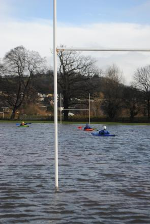DAMP SQUIB: With The Christ College Schools Sevens tournament cancelled, local kayakers took to the pitches instead. Pic: Huw S Thomas