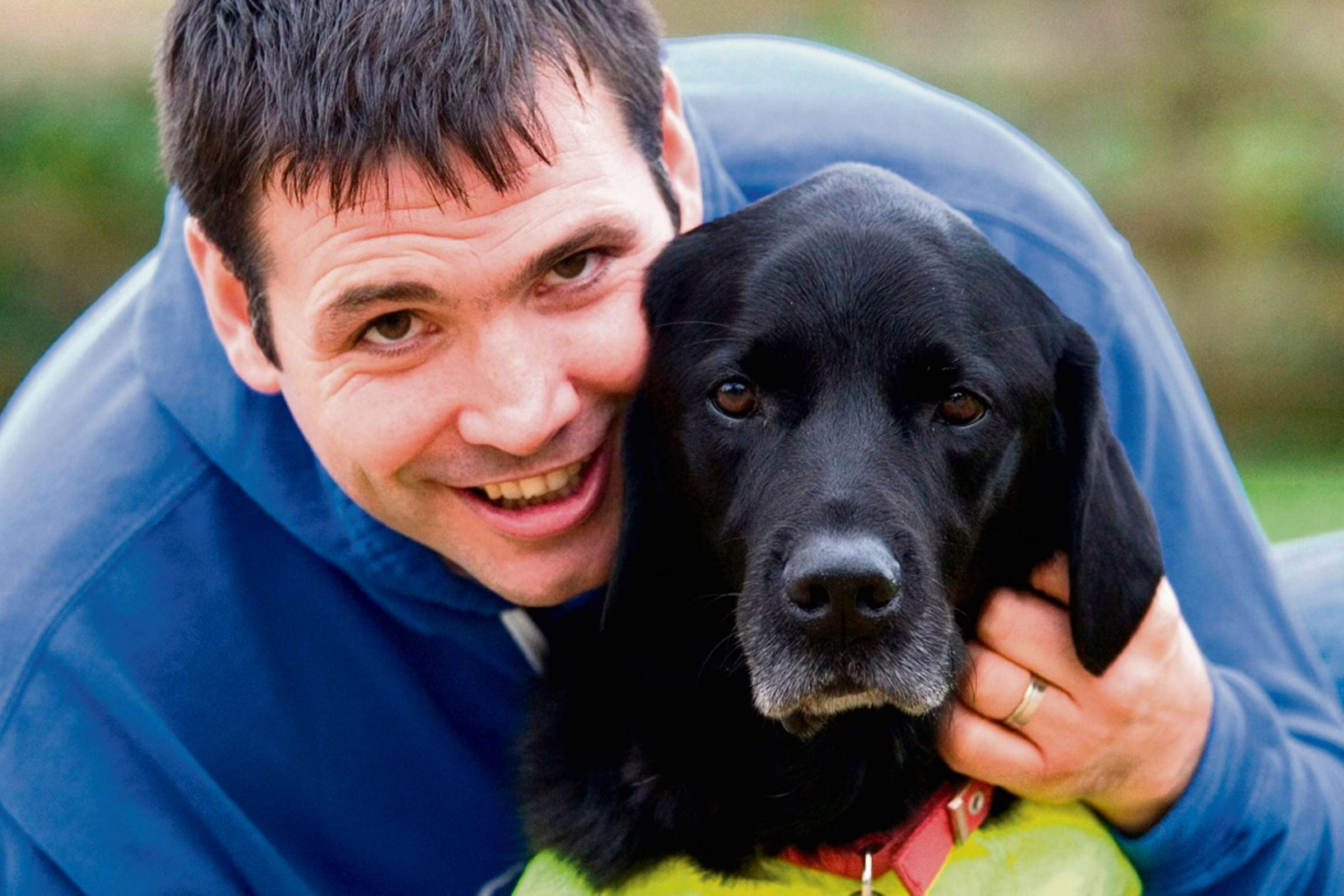 Konrad Galen-Bisping of Talley and his guide dog Radley who have made it to the final of Friends for Life in this year's Crufts.