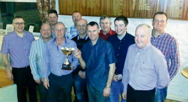 IN THE SWING: Glynhir Golf Club's Rabbits team captain Martin Toms and Vice-Captain Richard Thomas raise the Division Two Champions Cup after a fantastic season.