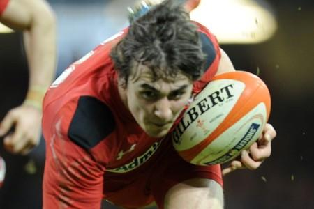 JOYOUS MOMENT: Rhodri Williams dives in to score his first Welsh try in the rout of Scotland.