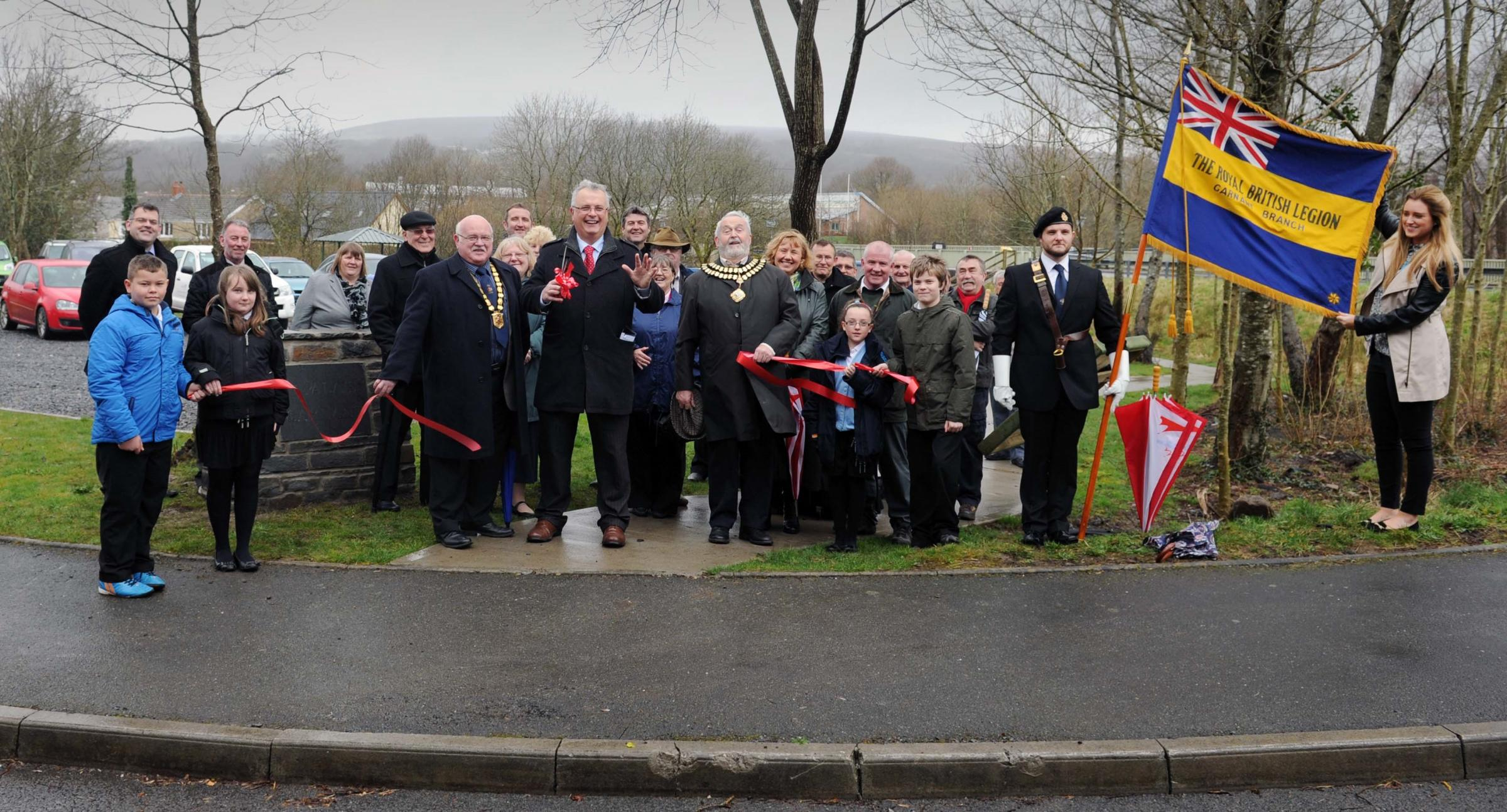 RIBBON DEVELOPMENT: Carmarthenshire County Council Leader Cllr Kevin Madge cuts the tape to open the car park.