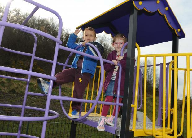 PLAY IT AGAIN: Four-year-old Josh Doorbar and pal Evie Williams enjoy the new playground. Picture: Jeff Connell.