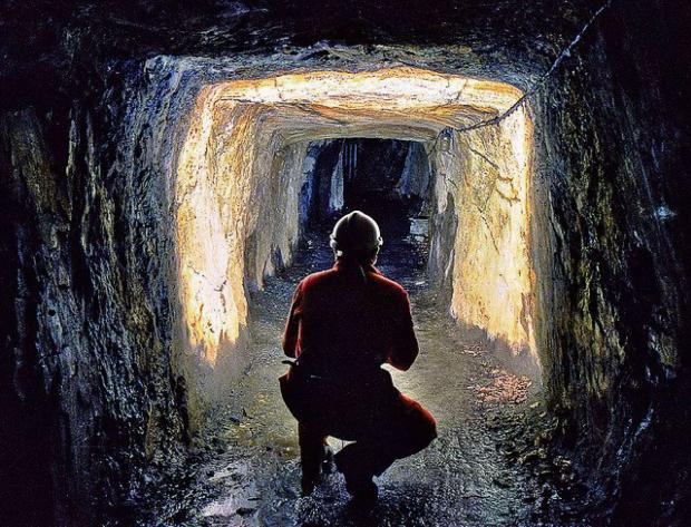 GOING UNDERGROUND: |A worker inspects the newly-discovered tunnel near Tirydail.