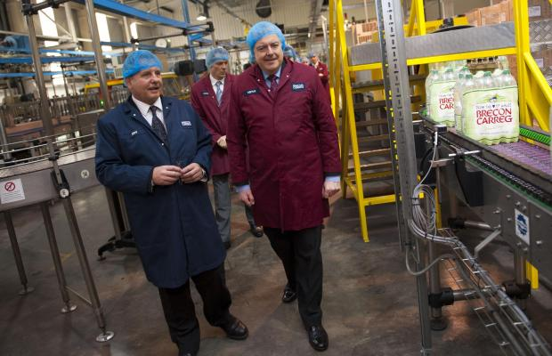 South Wales Guardian: VIP TREATMENT: First Minister Carwyn Jones is given a tour of the factory by Jeff Phillips, production manager of Brecon Carreg.