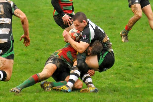 South Wales Guardian: CRUNCH: Llandeilo's Aled Tommason has his run stopped in it's tracks by Llanybydder's Gary Evans.  Llanybydder beat the home team 13-18 in their Division Three West clash.  Picture by Mark Davies