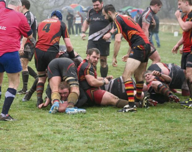 GRASSROOTS RUGBY: John James scores the first try for Tycroes against Cardigan.