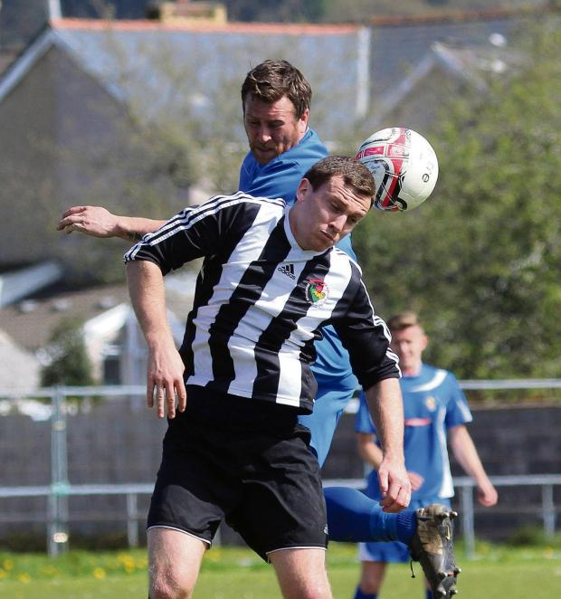 South Wales Guardian: FLYING FISHER: Ammanford's Matthew Fisher rises to head against Chepstow Town in the 0-0 draw.Pic: SDD