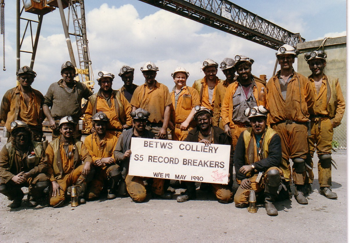 RECORD-BREAKERS: This team of Betws miners celebrate a coal production record.