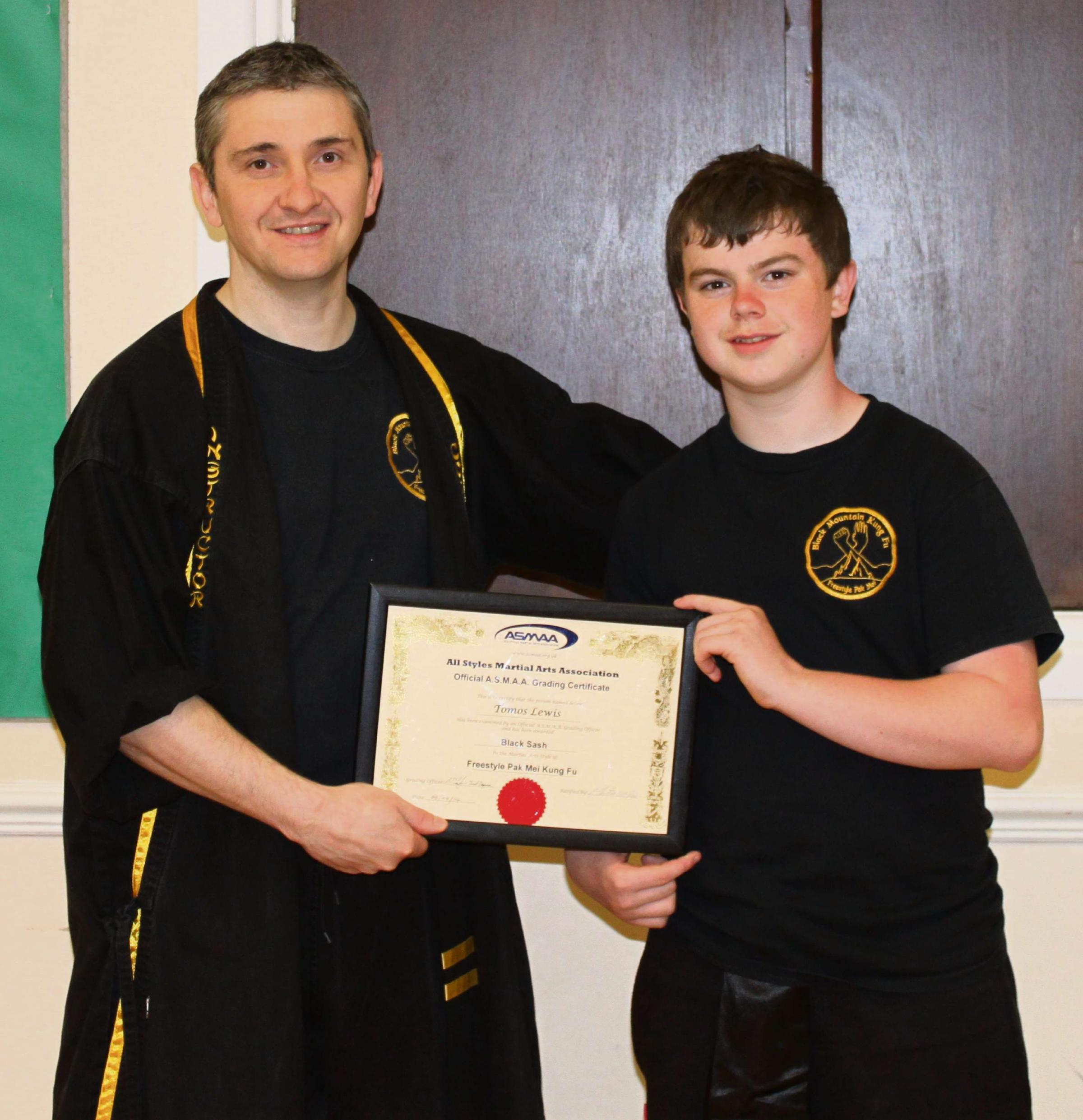 KUNG FU KID: Brynaman's Tomos Lewis collects his black sash certificate form Eighth Dan Master Carl Coppini.
