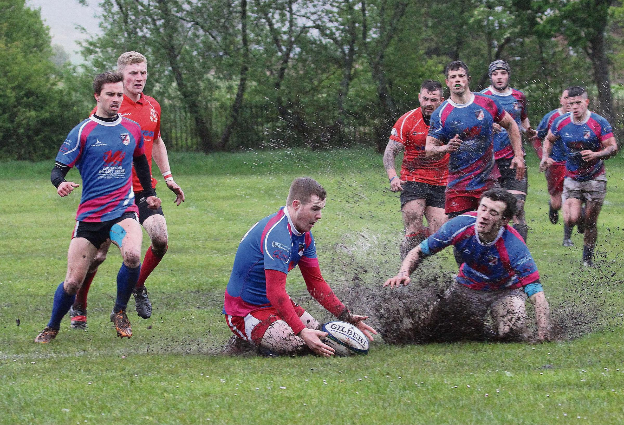 SLIP SLIDING AWAY : Christian Madge claims the ball for Cwmgors as the Cherries lose 16-12 to Cwmavon – but Cwmgors need just a point for the title. Pic: SDD