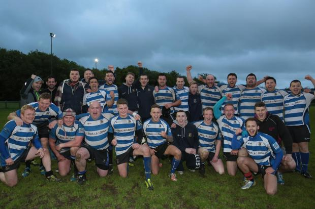 PRIDE OF THE VALLEY : The victorious Ystrad team cel - ebrate their triumph. Picture: Riley Sports.
