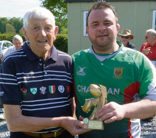 South Wales Guardian: GREEN DREAMS: The All Wales Sport League Division Three trophy is presented to Brynamman skipper Haydn Morgan by Llanelli District life member and past president, Alun West, following defeat in the Morgan Finance Millennium Plate.