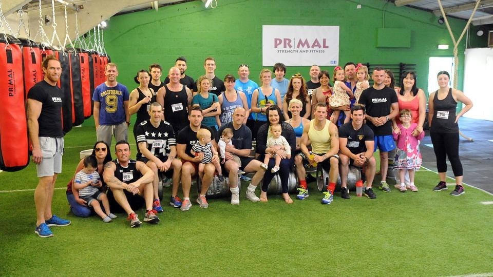 CHARITY IRON: Members of the Primal Gym raised £519 in aid of little Alfi Jay Morris (pictured sister Besi and mum and dad