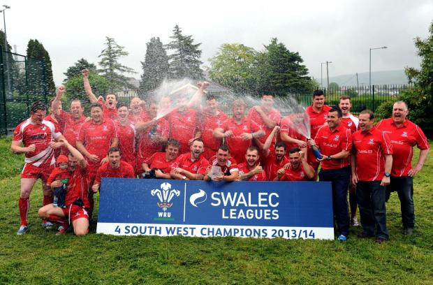 South Wales Guardian: CHAMPIONS: Cwmgors celebrate winning Swalec Division  Four South West. the trophy was presented to the club last week by WRU Board Member Brian Fowler. Pic: Huw Evans Agency.